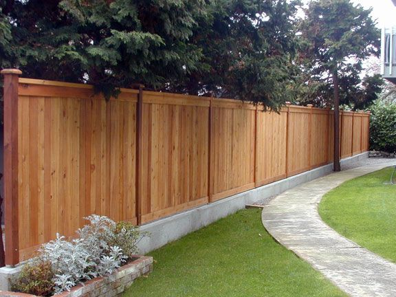privacy fence on concrete